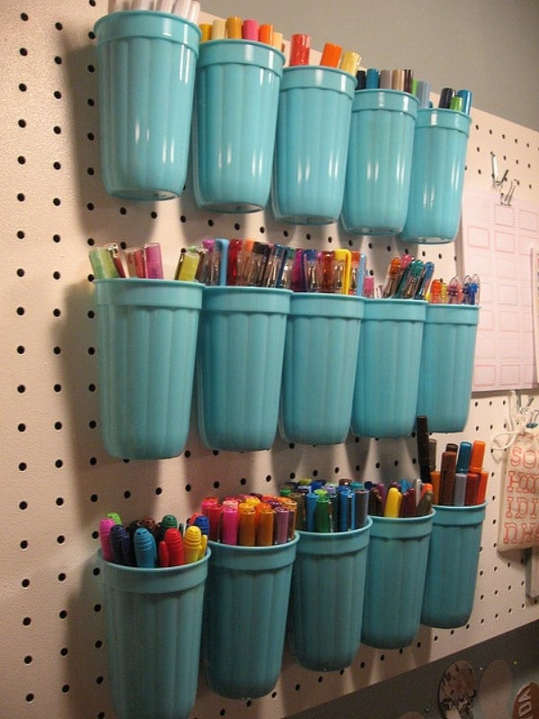 Plastic Cups on a Pegboard - 49 Brilliant Garage Organization Tips, Ideas and DIY Projects