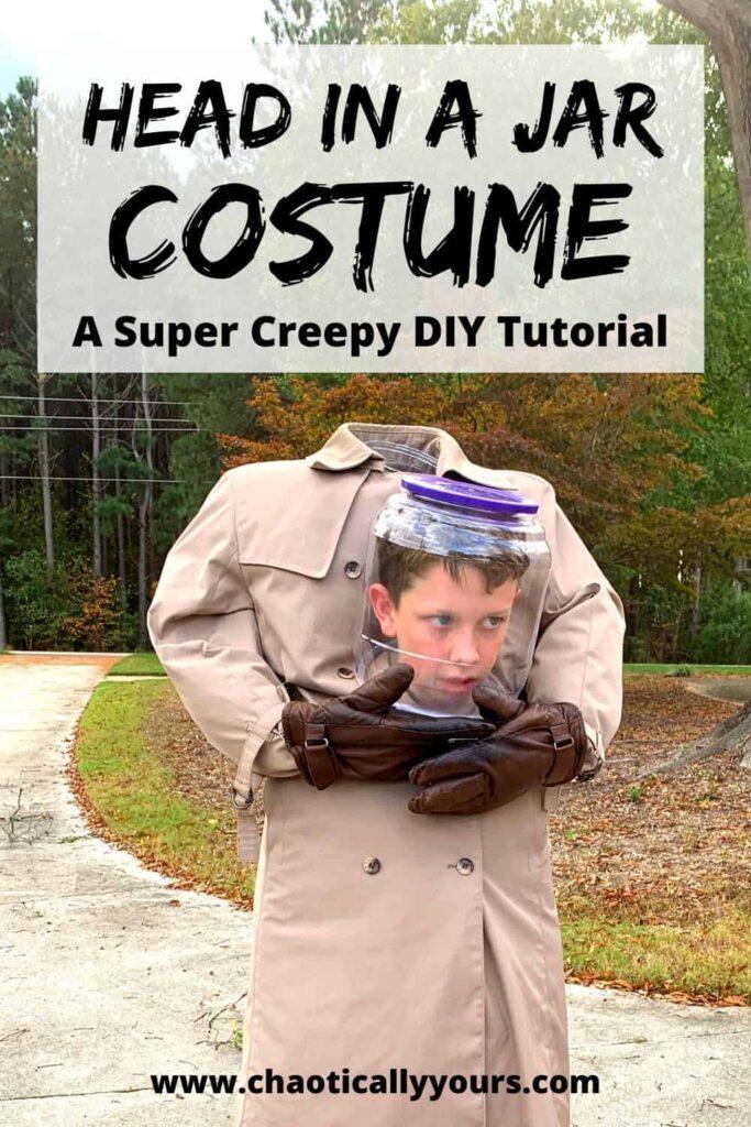 Boy head in a jar costume on driveway