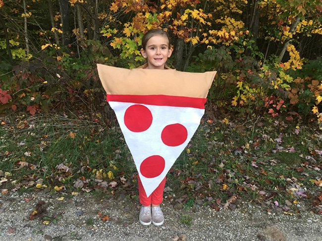 Girl in pizza costume outside