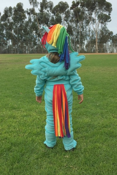 Child in rainbow unicorn costume