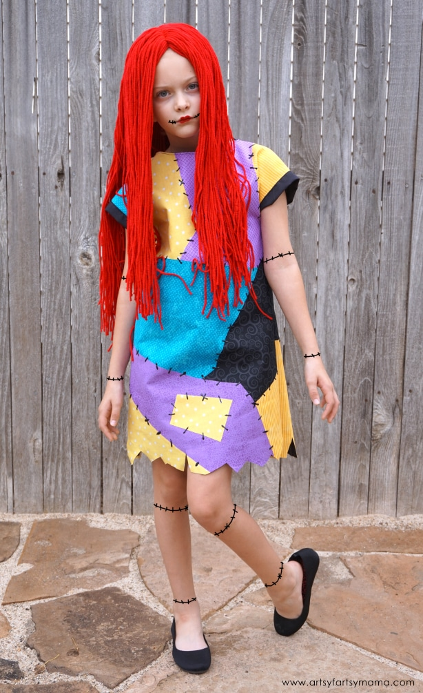 Sally costume by wood fence