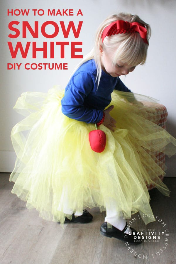 Toddler in snow white costume