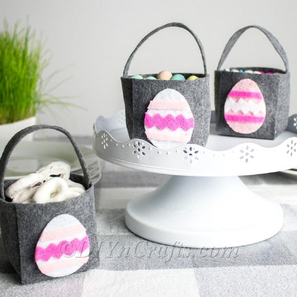 Grey and pink easter bags on white stand