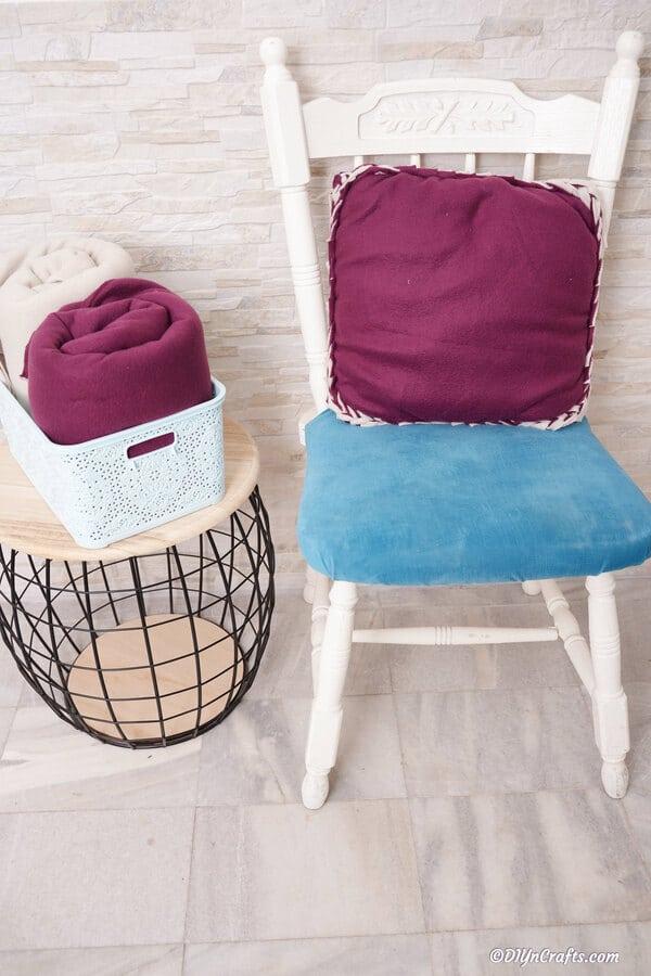 Purple fleece pillow on chair