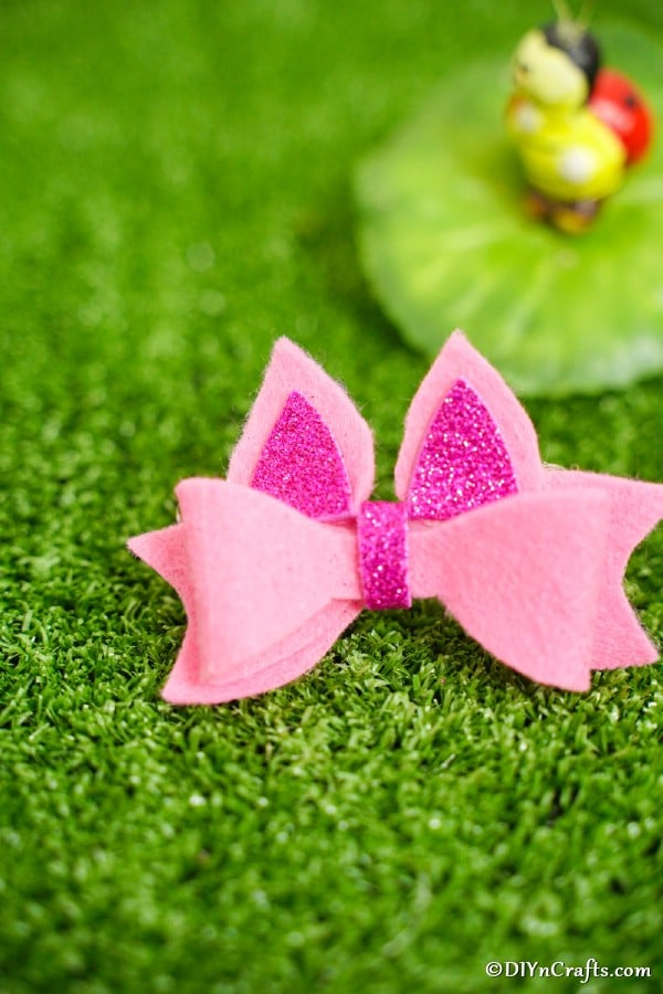 Pink bow on grass