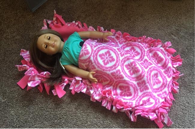 Pink fleece blanket on American girl doll