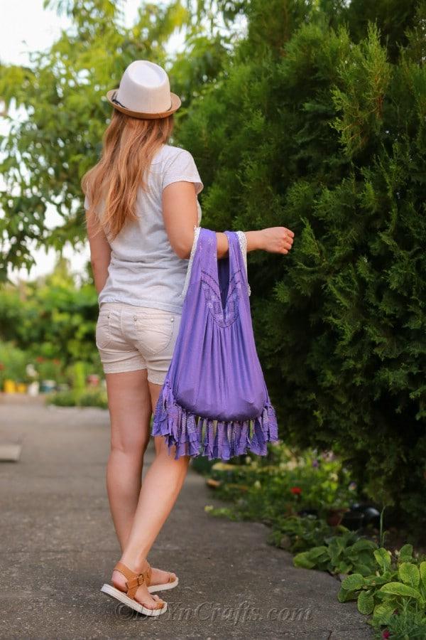 Girl holding purple tshirt bag