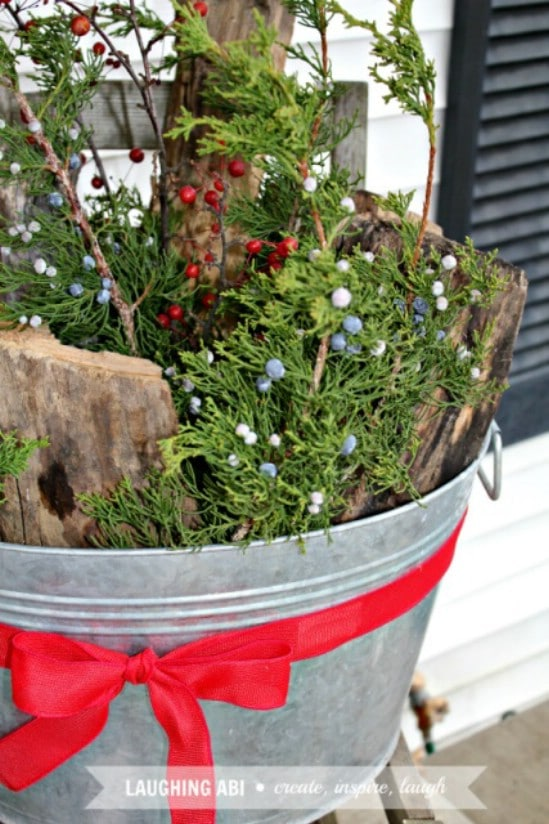 Use Buckets - 60 Beautifully Festive Ways to Decorate Your Porch for Christmas