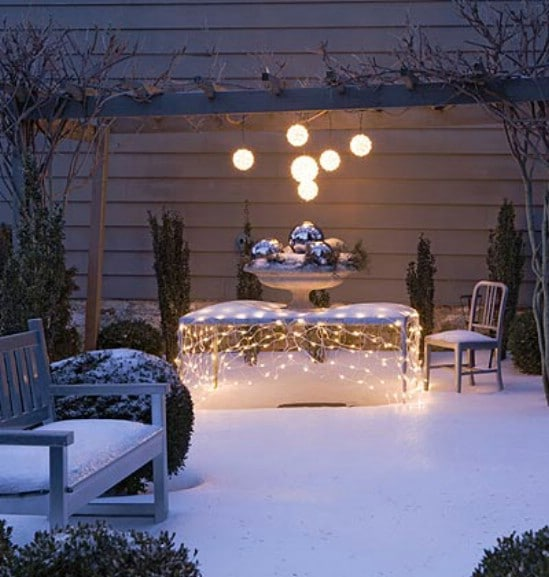 Set an Outdoor Table - 60 Beautifully Festive Ways to Decorate Your Porch for Christmas