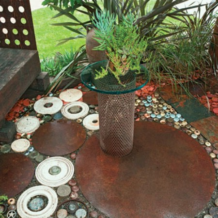 Use Knobs From Broken Doors For Patio Flooring