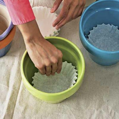 Stop leaking planters from getting dirt everywhere with coffee filters.