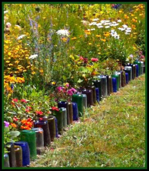 Use glass bottles to edge your garden path.