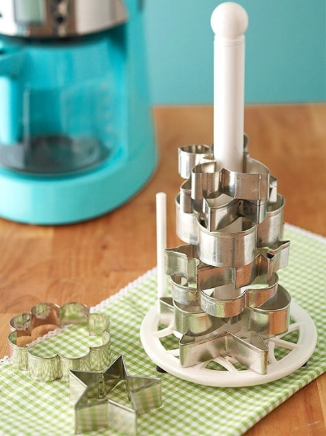 Organize cookie cutters with a paper towel rack.