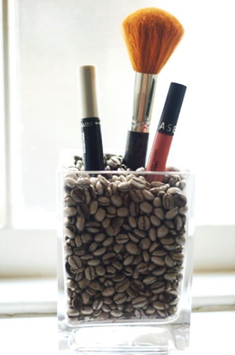 Fill a vase with coffee beans for your brushes.