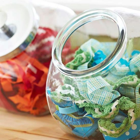 Store craft supplies in vintage candy jars.