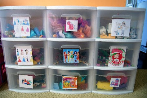 Put pictures on plastic bins so that children understand where to put their toys.