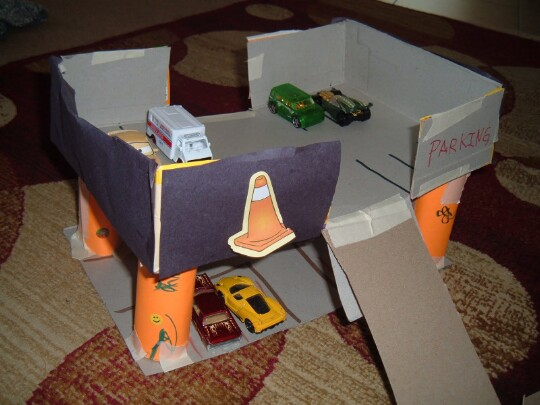 44. Drive a toy car up into a cereal box parking garage.
