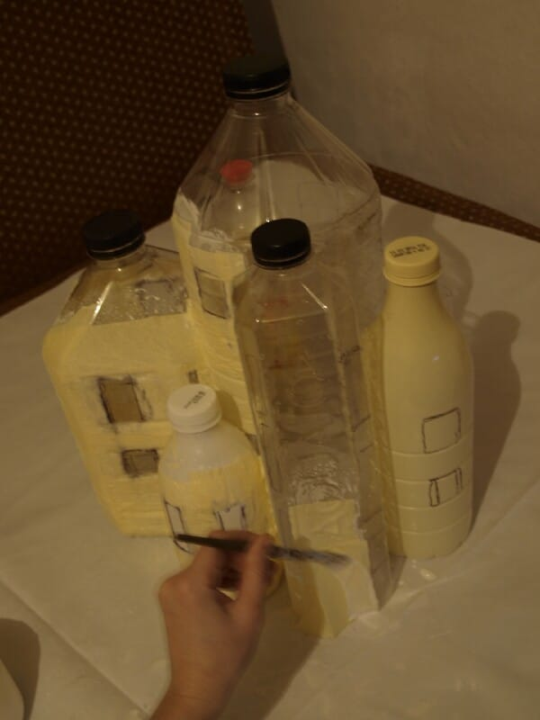 Cover the bottles with glue.