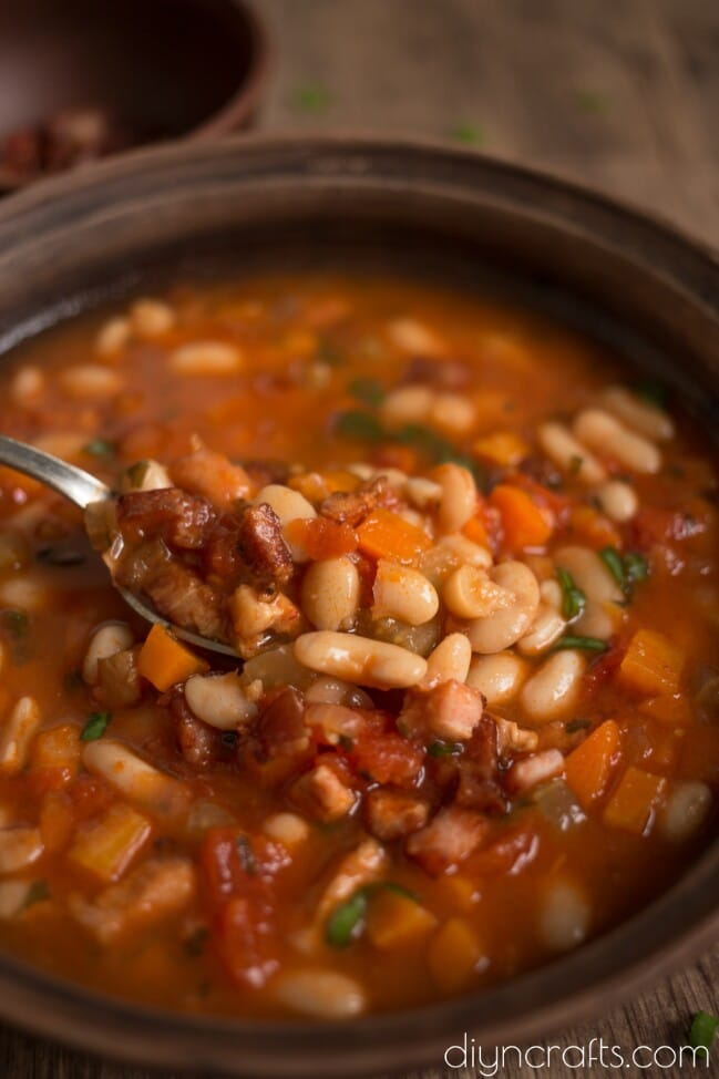 Close view of the finished white bean with crispy bacon soup.