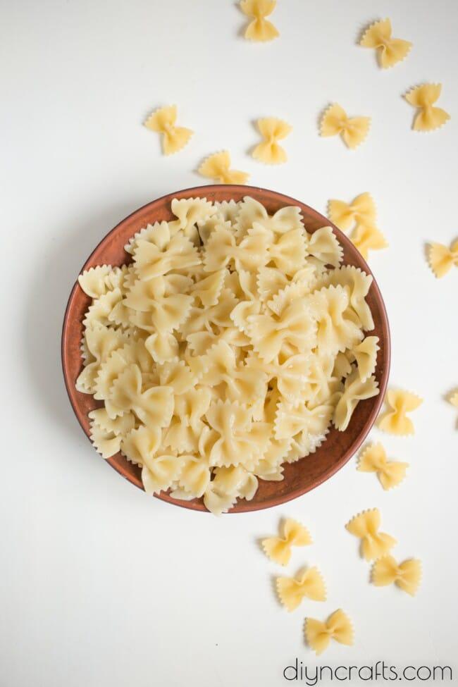 Bow tie pasta ready to be mixed.