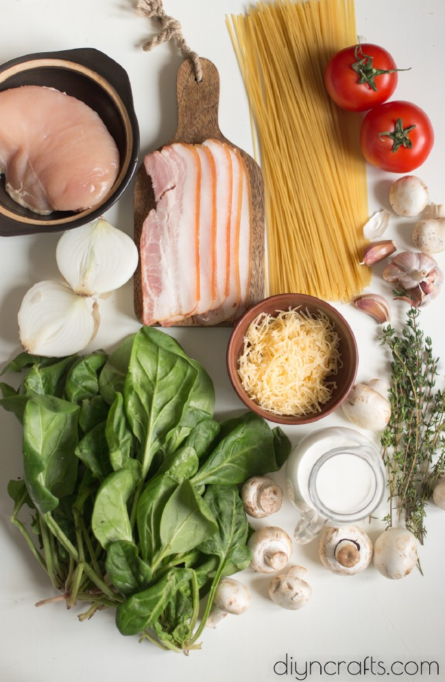 Ingredients for chicken, bacon, and spinach spaghetti.