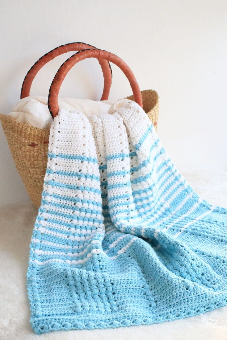 Blue and white striped blanket in basket