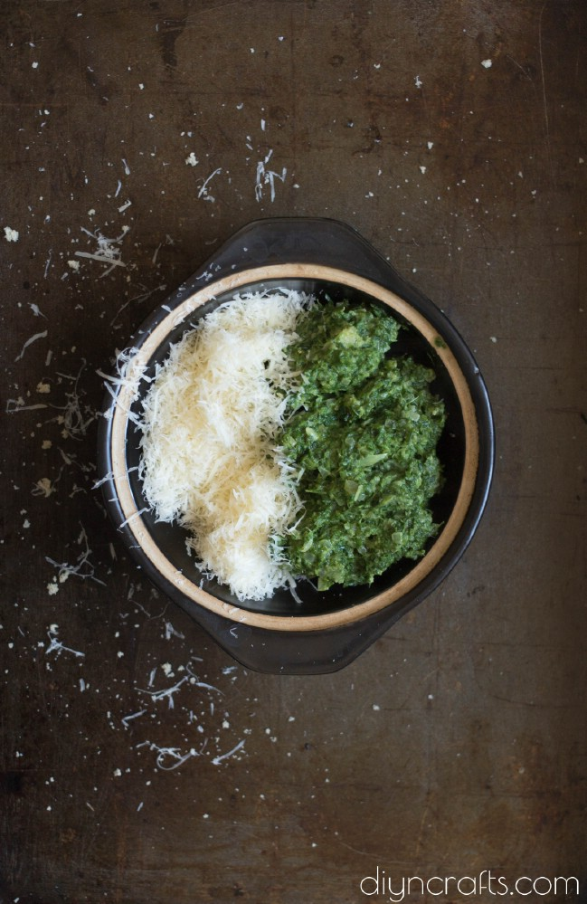 Mixing spinach and parmesan cheese.