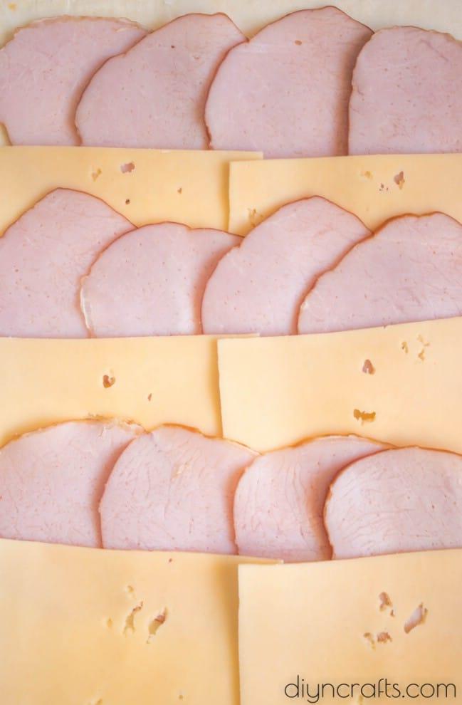 Layer ham and cheese.