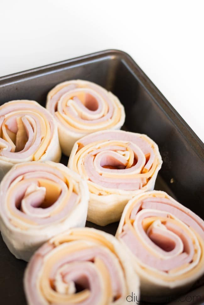 Sliced bacon and cheese roll ups.