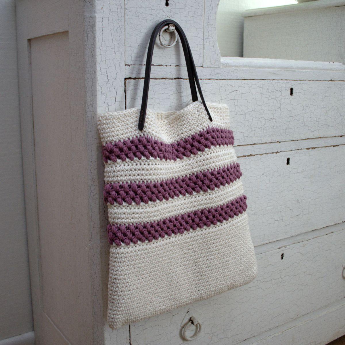 Striped crochet bag hanging on drawer knob