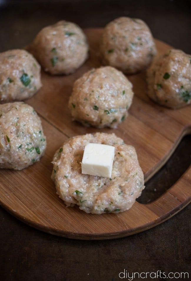 Adding the mozzarella into the meatballs.