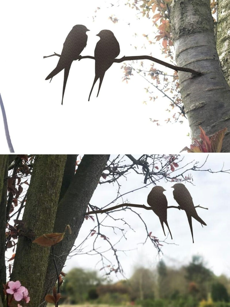 Rustic metal birds on a tree.