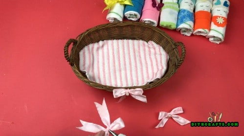 Line the bottom of a basket with a small blanket or large washcloth.