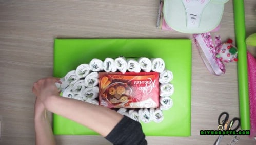 Add more diapers so that you can create the shape of a deck.