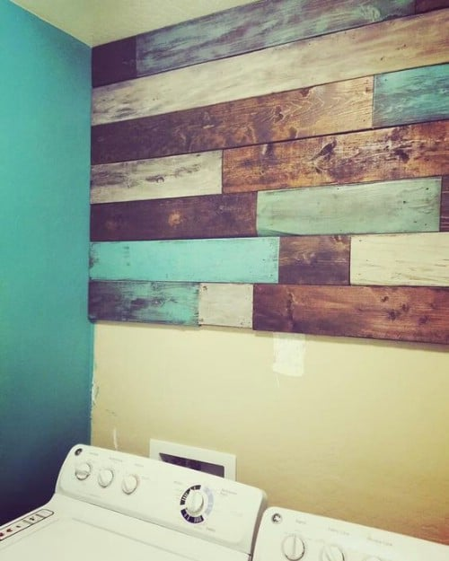 Paint some sections of wood in teal and leave others bare.