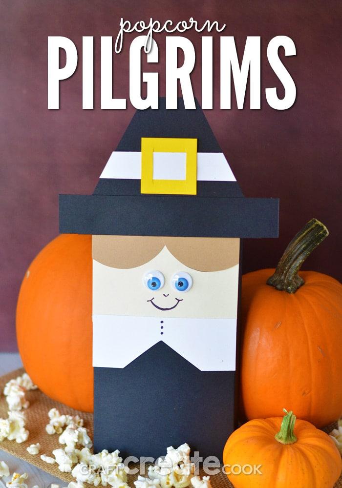 Paper pilgrim against pumpkins