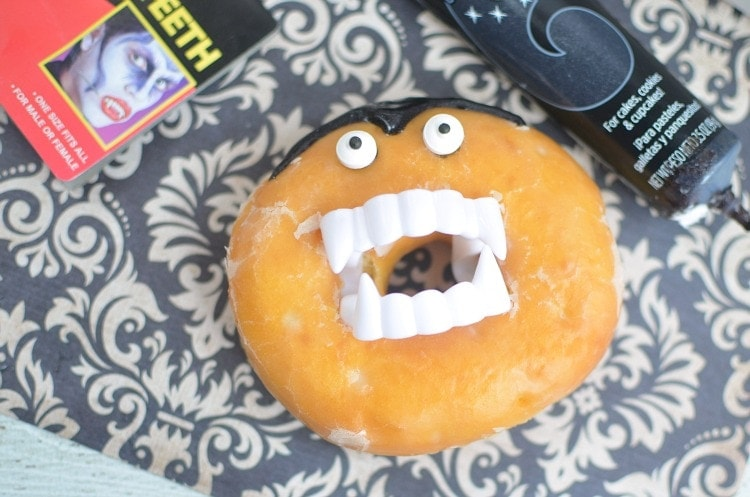 Glazed donut with vampire teeth