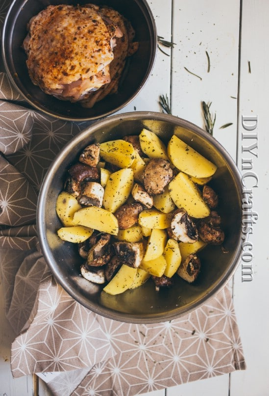 Potatoes and mushrooms are mixed with oil and herbs for flavor