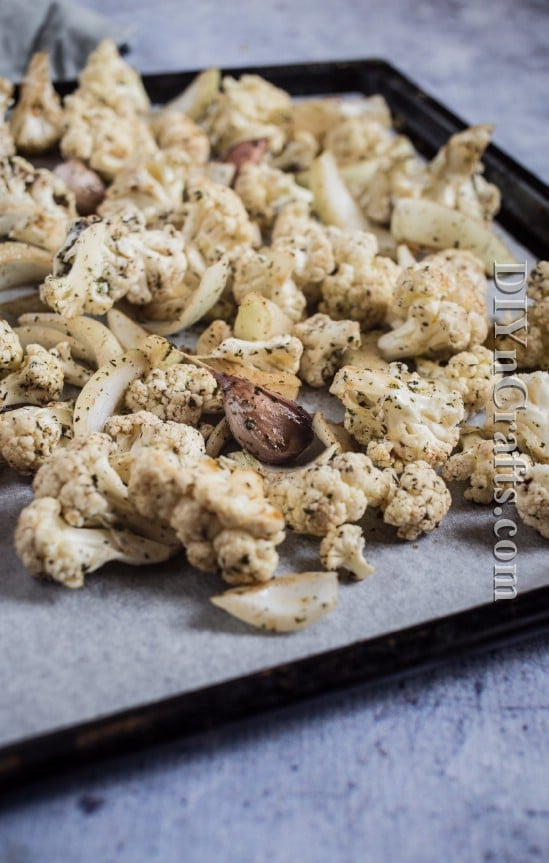 Chop cauliflower and mix with onion, garlic and olive oil