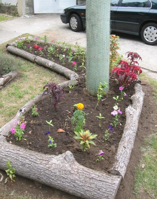Repurposed Tree Trunk Garden Fence