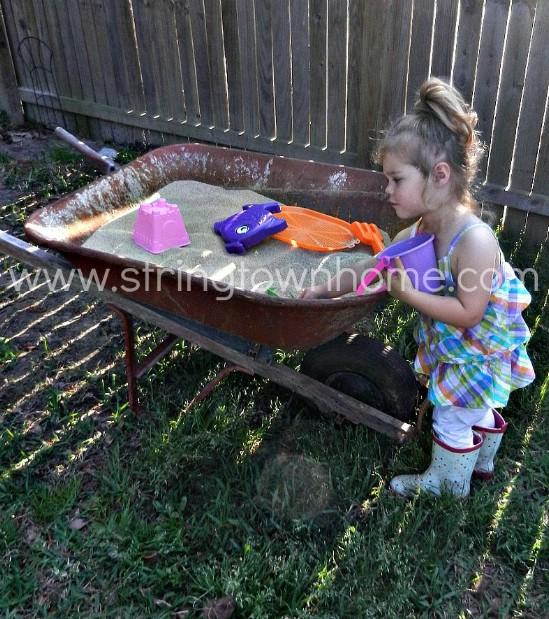 Easy Repurposed Wheelbarrow Sandbox