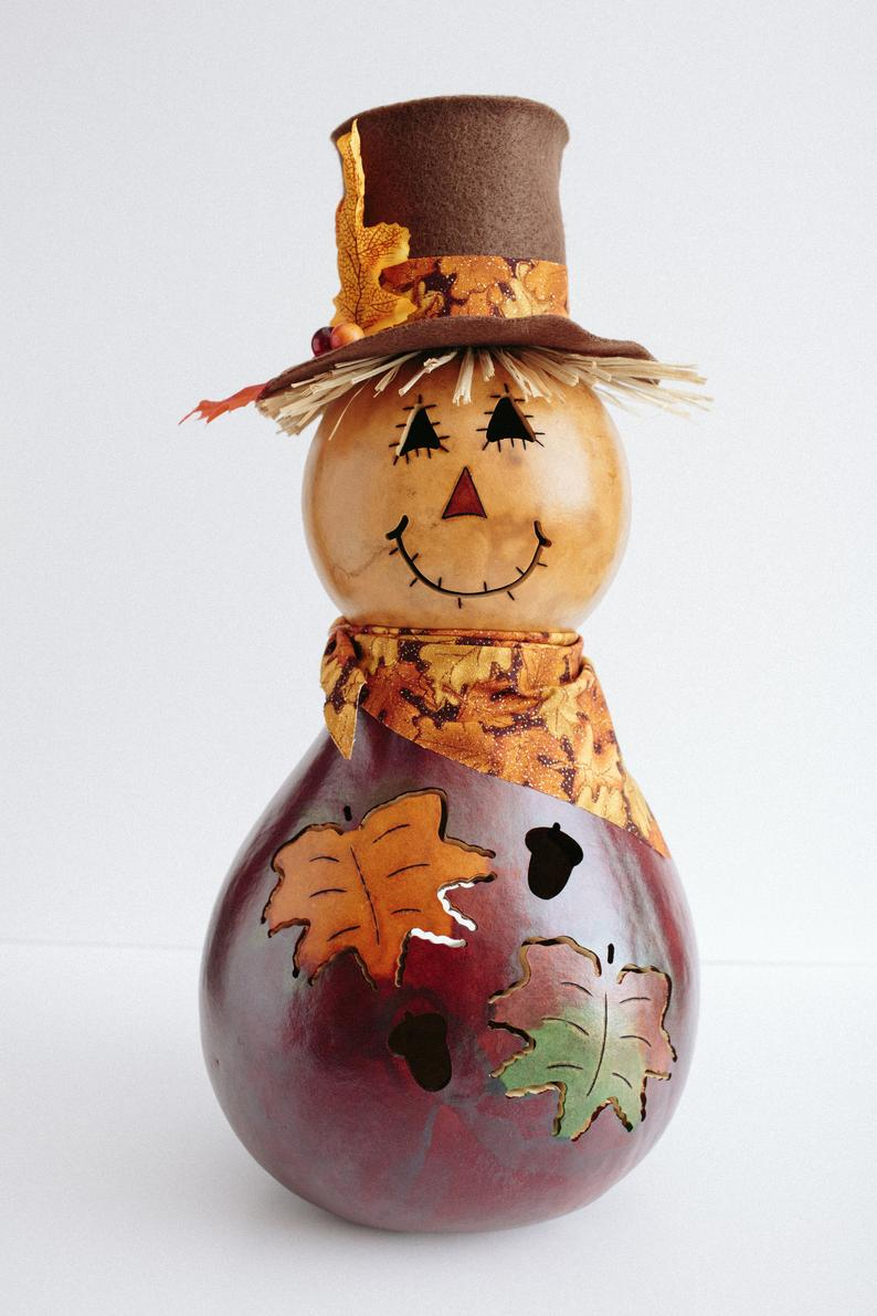 Gourd scarecrow on white surface