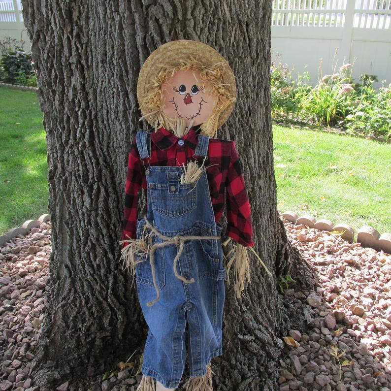 Scarecrow against tree