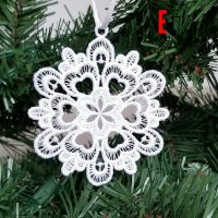 Embroidered lace snowflake ornaments.