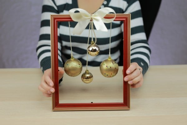 "How to Make a Classy Christmas ""Wreath"" Out of an Old Picture Frame"