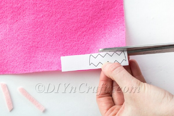 Cutting the egg decoration using the printable template.