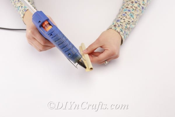 Applying glue to create fixed book page rolls.