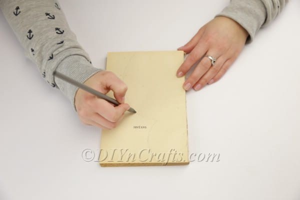 Drawing the bunny shape on the pages.