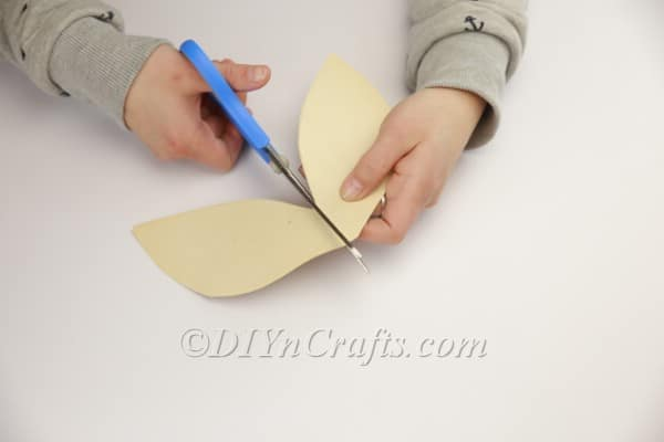 Using scissors to cut them evenly.