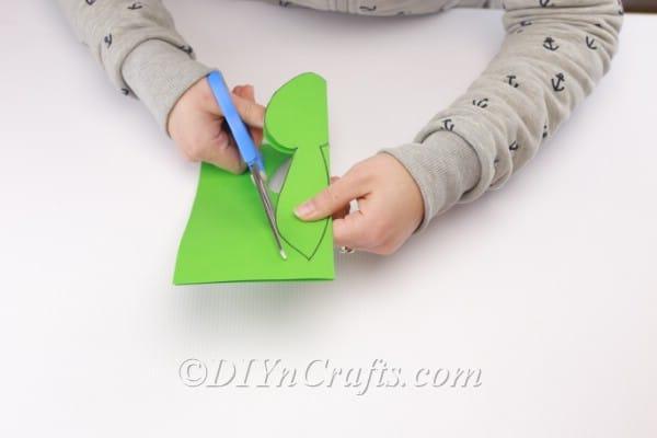 Cutting the drawn head shape.